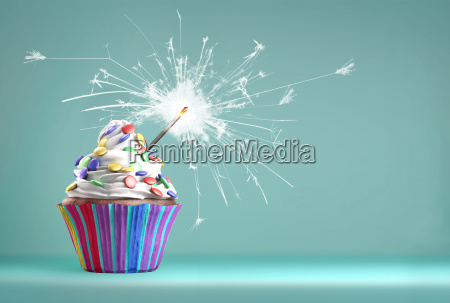 delicious cupcake with a sparkler for