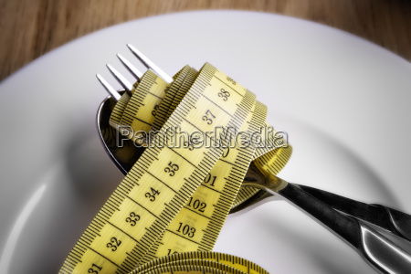 tape measer with fork and spoon
