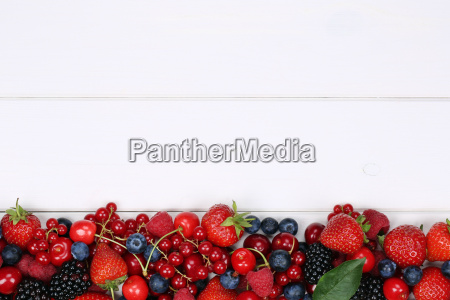 berries fruits on wooden board with