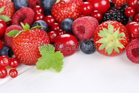berries fruit on wooden board with