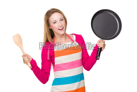 young woman holding up with frying