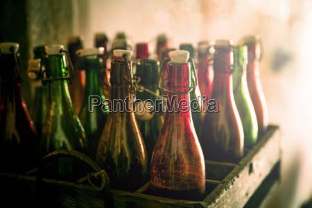 old beer bottles in a wooden