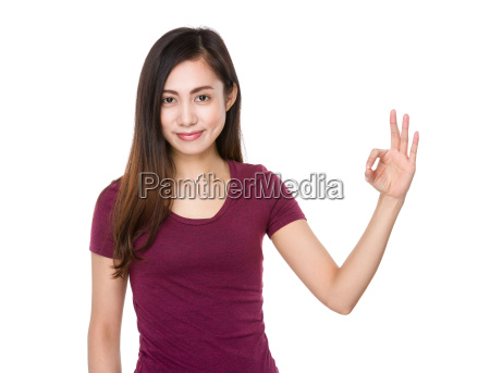 young girl with ok sign gesture