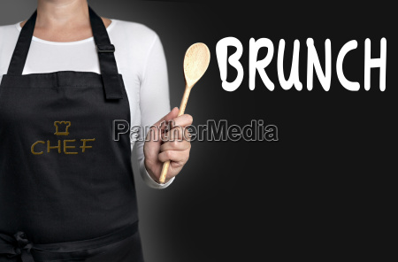brunch cook holding wooden spoon background