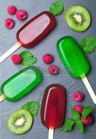 water ice with fruits on blackboard