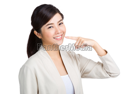 woman showing her toothy smile