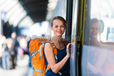 pretty young woman in a trainstation
