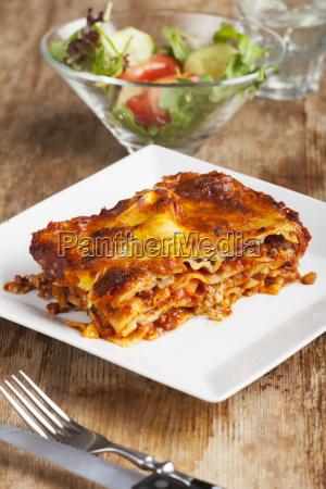homemade lasagna on rustic wood