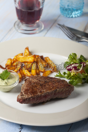 slice of beef steak with french