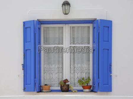 window with shutters in greece