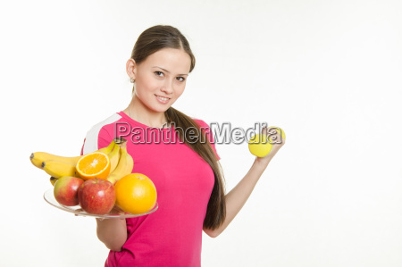 girl athlete holding a plate of
