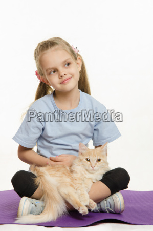 thoughtful girl with a cat on
