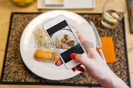 taking a picture of the food