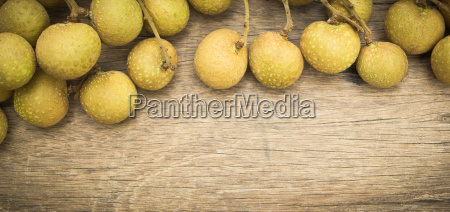 longan on wooden background tropical fruit