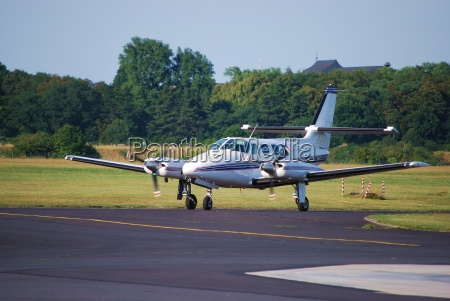 a piper passenger plane is waiting
