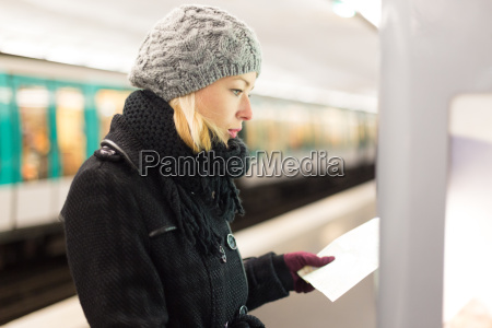lady looking on public transport map