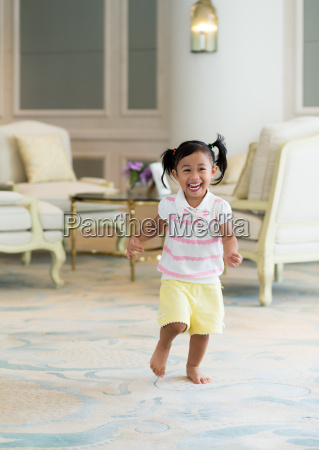 excited girl running at home