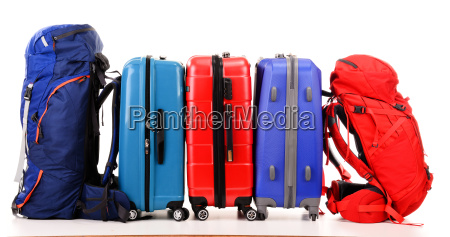 suitcases and rucksacks isolated on white