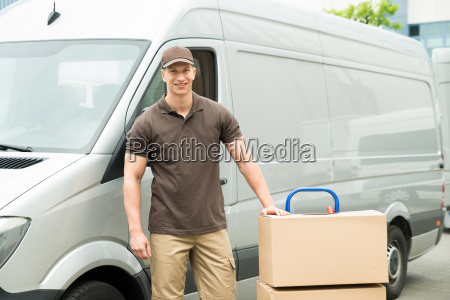 delivery man with cardboard boxes on