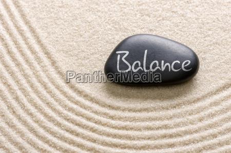 black stone with the inscription balance