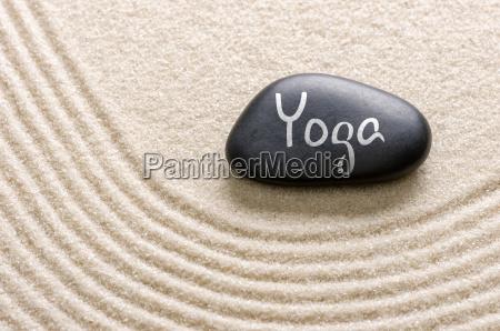black stone with the inscription yoga