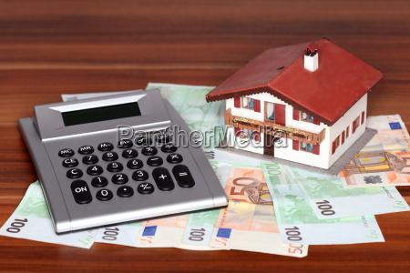 money calculator and house