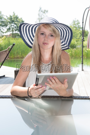 attractive young woman with hat working