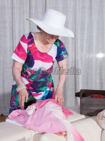 active female senior is packing vintage