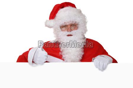 santa claus shows thumbs up christmas