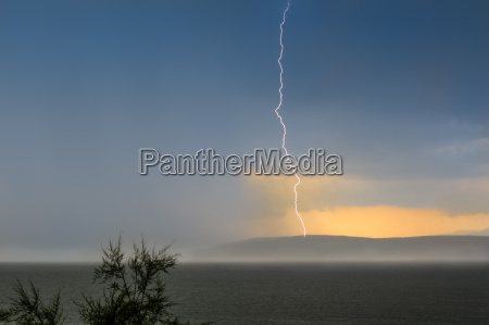 lightning strikes the sea in island