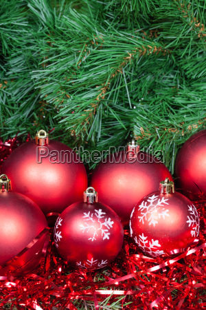 several red christmas baubles tinsel and