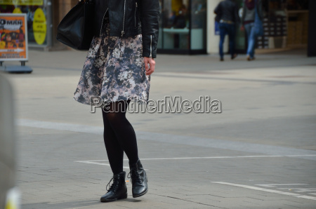 woman with short skirt and leather