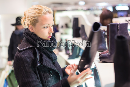 beautiful woman shopping in shoe store