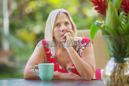 nervous woman biting fingernails