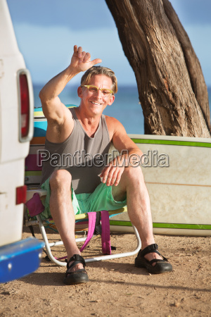 athletic male surfer relaxing
