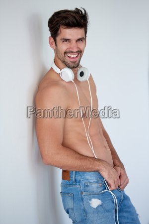 handsome young man listening music on