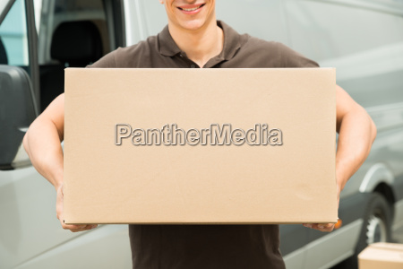 delivery man carrying box in hand