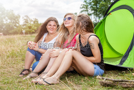 group of friends enjoying a camping
