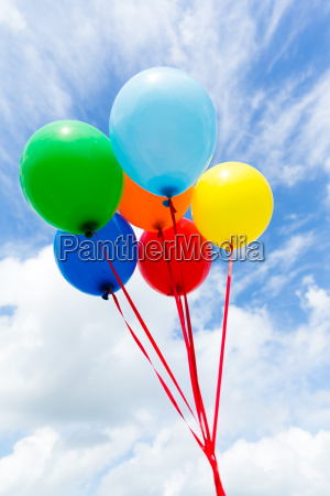 bunch of colorful balloons in blue