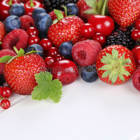 berry fruits with strawberries raspberries cherries