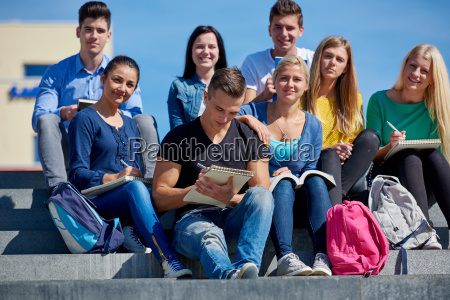 students outside sitting on steps