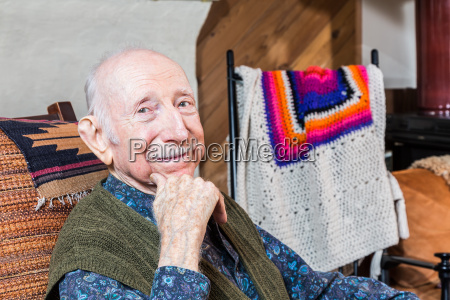 older smiling gentleman sitting