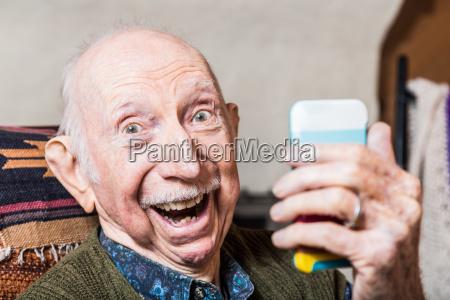 older gentleman taking selfie