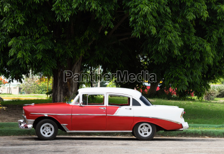 cuba red white vintage car parked