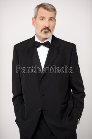 elderly man in elegant dark formal