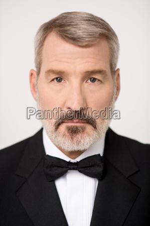 mature man posing to camera