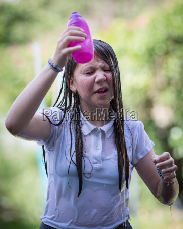 teenage girl cools down by throwing