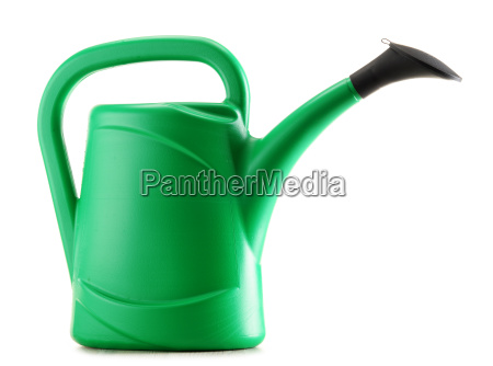 green plastic watering can isolated on