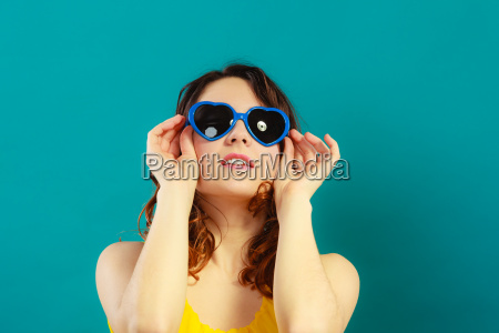 girl in blue sunglasses portrait