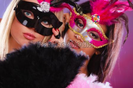 two women with venetian carnival masks